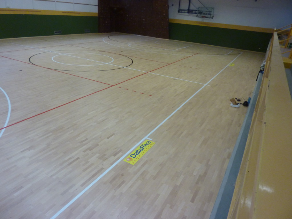 The logo of Dalla Riva Sportfloors stands on the floor of another gym in the province of Sondrio
