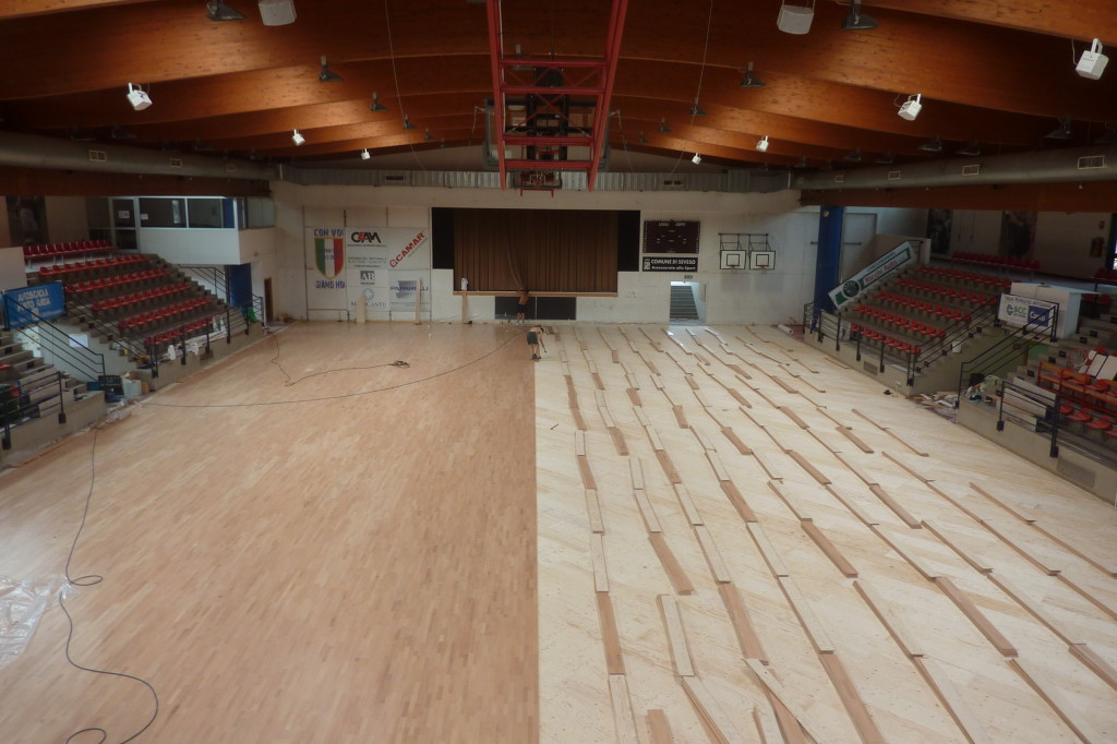 The new sports floor inside the building used by Briantea 84 is taking shape