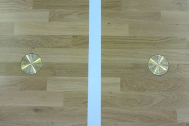 A particular new brass rings inserted in the new sports flooring in beech placed in Cerro Maggiore