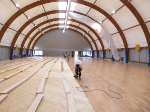 Technicians of Dalla Riva Sportfloors at work in the gym of Trecate